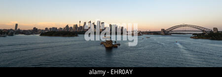 Cruising into Sydney harbour early morning during sunrise. - Stock Photo