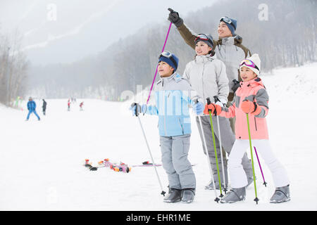 Young family skiing in ski resort - Stock Photo