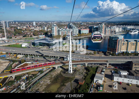 The Emirates Airline or Thames Cable Car connects the O2 Arena with the Royal Docks of London. - Stock Photo