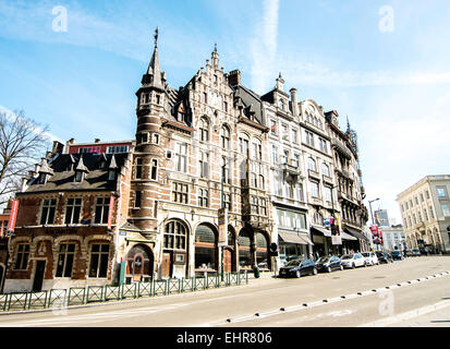 Historic building facades on a hilly street in Brussels, Belgium. - Stock Photo