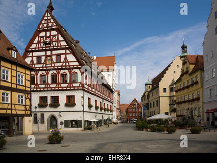 Street scene with half-timbered buildings in the medieval town, Nördlingen, Bavaria, Germany - Stock Photo
