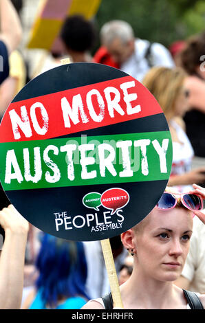 Woman holding No More Austerity placard at the People's Assembly march against Austerity, London, 21st June 2014 - Stock Photo