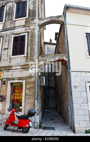 Red Moped Parked near Archway in Omis, Croatia - Stock Photo