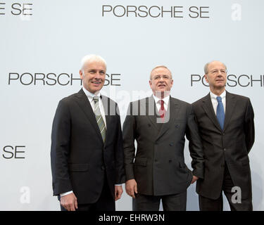 The CEO of Porsche SE, Martin Winterkorn (C), the CFO of Porsche SE, Hans Dieter Poetsch (R), and the Chairman of - Stock Photo