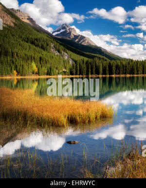 Clouds and reflection in Waterfowl Lakes. Banff National Park. Alberta. Canada. - Stock Photo