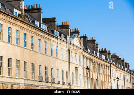 Angled view of terraced Georgian houses in Bath, Somerset, on a sunny day with clear blue sky. - Stock Photo