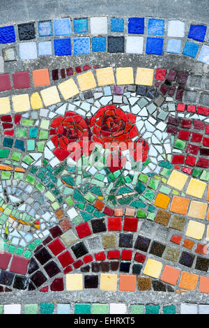 Rose mosaic made from coloured tiles on a harbour wall in Eyemouth, Berwickshire, Scotland - Stock Photo