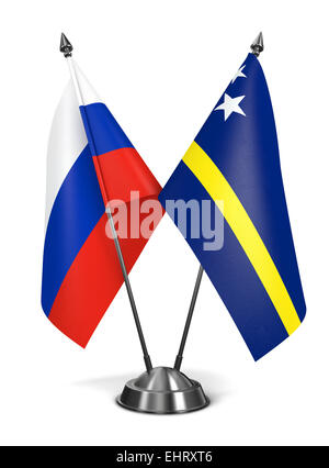 Russia and Curacao - Miniature Flags. - Stock Photo