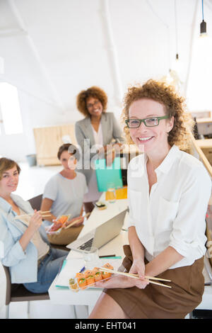 Office workers having lunch together - Stock Photo