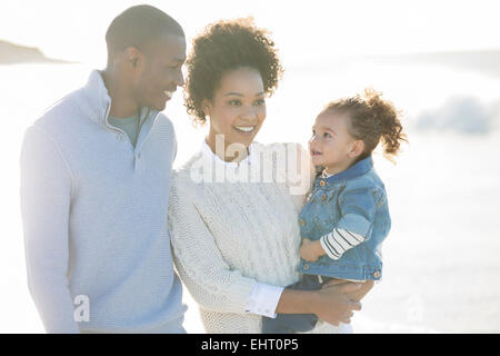 Portrait of happy family in sunlight - Stock Photo