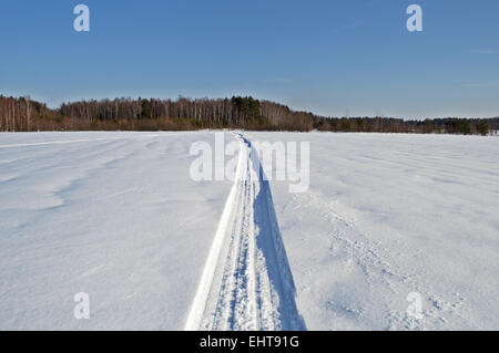 Snowmobile trail in the field - Stock Photo