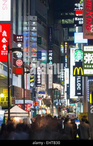 Asia, Republic of Korea, South Korea, Seoul, neon lit streets of Myeong-dong - Stock Photo