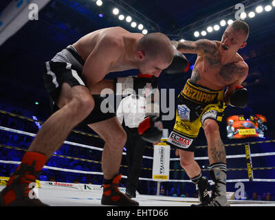 LUBIN, POLAND - MARCH 14, 2015: Professional boxing fight between Michal Lesniak (yellow short) and Lukas Leskovic - Stock Photo