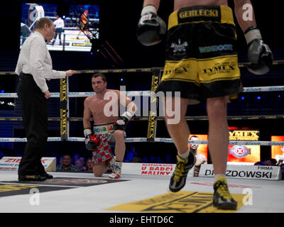 LUBIN, POLAND - MARCH 14, 2015: Professional boxing fight between Michal Gerlecki (black short) and Stjepan Bozic - Stock Photo