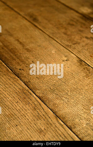 A Background Texture Of Old Wooden Floorboards - Stock Photo
