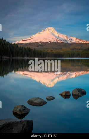 Setting sunlight on Mount Hood from Trillium Lake, Cascade Mountains, Oregon, USA - Stock Photo
