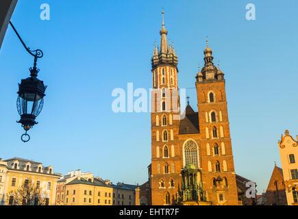 Mariacki church in Rynek Glowny - The main square of Krakow in Polad. - Stock Photo