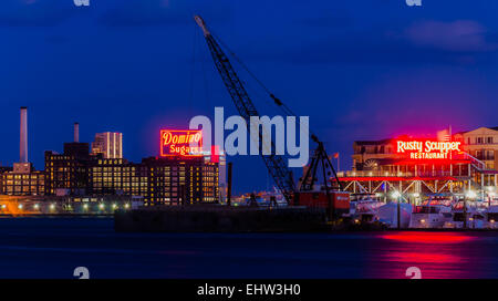 BALTIMORE - FEBRUARY 25: The Domino Sugars Factory at night on February 25th, 2012 in Baltimore, Maryland. This - Stock Photo