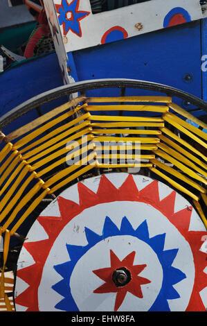 Durban, KwaZulu-Natal, South Africa, close-up, detail, colourful decorated wheel of rickshaw, city, people, transport - Stock Photo