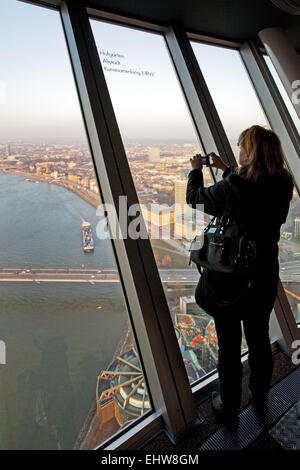 A woman photographed from the Rhine Tower. - Stock Photo