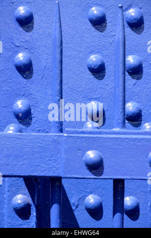 Newly-painted blue metalwork on a railway bridge over the river Medway, Maidstone, Kent, England, UK. - Stock Photo