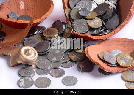Earthen pot is a coin box of rural India called Gullak. - Stock Photo