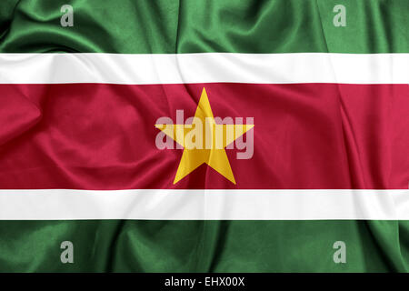 Suriname - Waving national flag on silk texture - Stock Photo