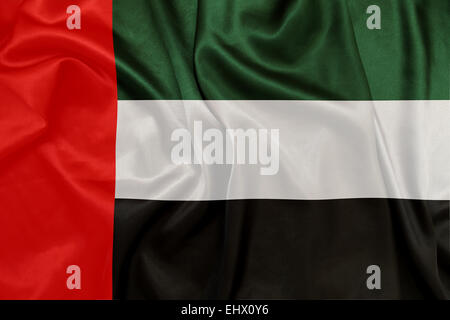 United Arab Emirates - Waving national flag on silk texture - Stock Photo
