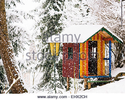 Germany, colorful wendy house in winter - Stock Photo