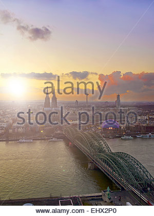Germany, Cologne, city view with Cologne Cathedral, Rhine River and Hohenzollern Bridge in the foreground - Stock Photo