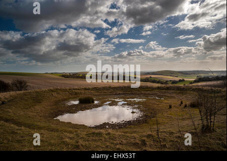 An ancient dew pond on the South Downs Way, West Sussex, UK - Stock Photo