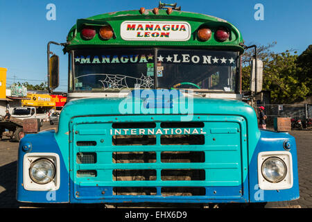 Colourful bus in the market place for the two north western cities of Managua and Leon; Leon Nicaragua - Stock Photo
