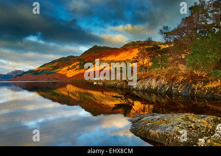 Looking over Loch Lomond towards the base of Ben Lomond, taken from the edge of the loch at Rowardennan - Stock Photo