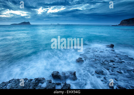 Spain, Ibiza, Cala Comte at blue hour - Stock Photo