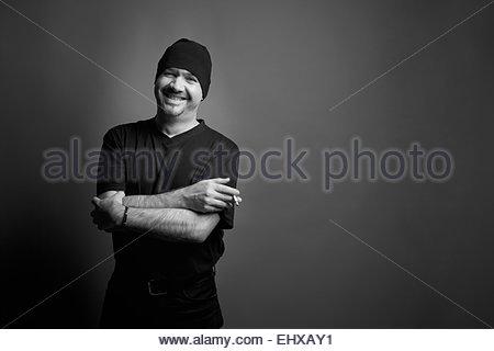 Black and white portrait man smoking cigarette - Stock Photo