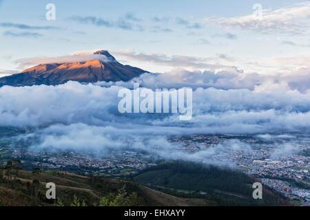 South America, Ecudador, Imbabura Province, Ibarra, Imbabura Volcano and fog in the morning - Stock Photo