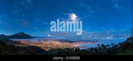 South America, Ecudador, Imbabura Province, View to Ibarra, full moon, Blue hour - Stock Photo