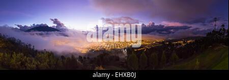 South America, Ecudador, Imbabura Province, Ibarra, blue hour and fog, Panorama - Stock Photo
