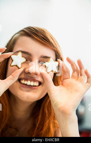 Close up of a red-haired young woman with cinnamon stars as eyes, Munich, Bavaria, Germany - Stock Photo