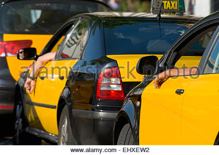 Row yellow black taxis waiting line - Stock Photo