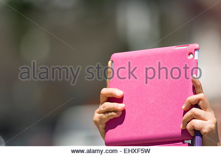 Close up pink tablet computer taking photo holding - Stock Photo