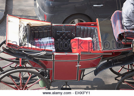 Horse drawn coach carriage red Vienna empty - Stock Photo