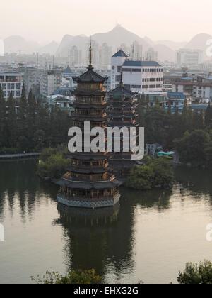 The Sun and Moon pagodas at Banyan lake in Guilin, China - Stock Photo
