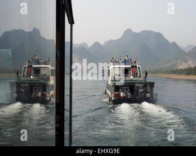 Tourist cruise boats on the Li river near Yangshuo, Guilin, China - Stock Photo
