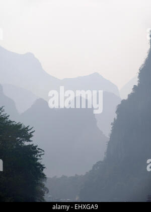 Hills in the mist near Yangshuo, Guilin, China - Stock Photo