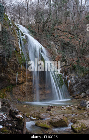 Such view waterfall Djur-djur has in winter. This is a famous waterfall of Crimea Mountains. - Stock Photo