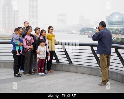 Asian man taking a family portrait - Stock Photo