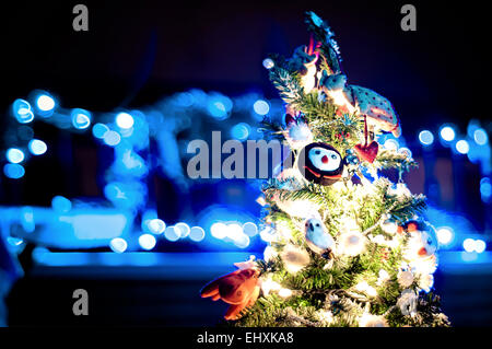 decorated Christmas tree with de-focused lights background - Stock Photo