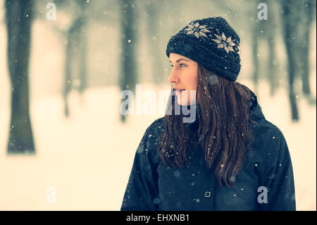 Young woman wearing wool cap in winter - Stock Photo
