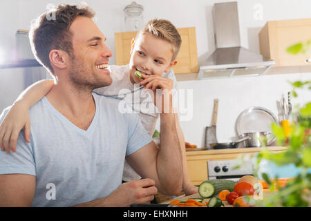 Father and son in the kitchen - Stock Photo